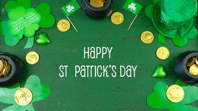 St Patrick`s Day leprechaun hat with decorations on green rustic background. St Patrick`s Day leprechaun hat with decorations on green rustic wood table Stock Photos