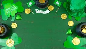St Patrick`s Day leprechaun hat with decorations on green rustic background. St Patrick`s Day leprechaun hat with decorations on green rustic wood table Royalty Free Stock Photo