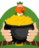 St. Patrick`s Day. Leprechaun and pot of gold. Magic dwarf and pot of golden coins. Royalty Free Stock Photography