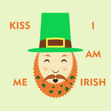 St. Patrick`s Day leprechaun with a symbolic green hat and bushy red beard. And green clover  background. Irish holiday celebration Stock Photography