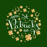 St. Patrick s Day lettering greeting card.Calligraphic inscription on a background of golden ornament with clover and. Horseshoe. Inscriptions thin pen on a Stock Photography