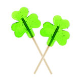 St Patrick's Day lollipops. Two clover leaf shaped St Patrick's Day lollipops isolated on white Royalty Free Stock Photo