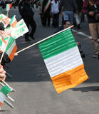 St.Patrick's Day Parade. A spectator holding an Irish flag at Stock Images