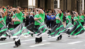 St. Patrick's Day Parade. A group of high school students in green dancing with flags up Fifth Avenue at the 251st annual St. Patrick's Day Parade in NYC Stock Photography