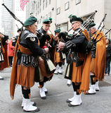 St. Patrick's Day Parade. Bagpipes players with traditional Irish Stock Photo