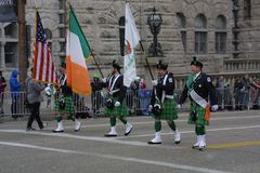 St. Patrick`s Day Parade 2017 Flag presenters. A view of the Union Station Hotel just before the parade began kilted flag carriers Green tartan Irish attire Stock Image