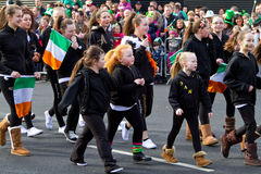 St. Patrick's Day parade in Limerick. LIMERICK, IRELAND - MARCH 17: Unidentified kids participate in a parade for St. Patrick's Day. It's a traditional Irish Royalty Free Stock Images