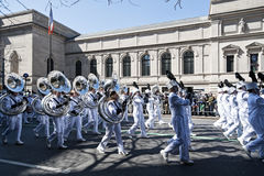 St. Patrick's Day Parade in NYC. High School Band in White marching in the St. Patrick's Day Parade - Circa 2009 Royalty Free Stock Image