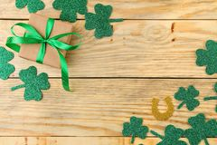 St.Patrick `s Day. Day of rest. Frame of green clover leaves on the natral wooden background. top view. space for text royalty free stock images