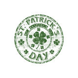 St. Patrick's Day rubber stamp. Green grunge rubber stamp with four leaf clover shape and the text St. Patrick's Day written inside the stamp stock illustration