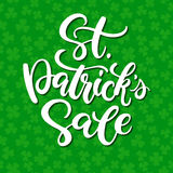 St. Patrick`s Day Sale lettering. Vector holiday discount poster. Isolated sign on green background. With clover pattern. Great for greeting card, poster, label Royalty Free Stock Photo