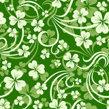 St. Patricks day seamless background with shamrock. Seamless pattern with shamrock on a green background Royalty Free Stock Images
