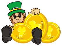 St. Patrick's day. St. Patrick sits next to the  golden cents Royalty Free Stock Photography