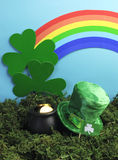 St Patrick's Day still life with leprechaun hat and rainbow. Vertical Stock Images