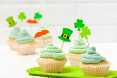 St. Patrick`s Day theme colorful horizontal banner. Cupcakes decorated with green buttercream and craft felt decorations in form. Of leprechaun hat, mustache royalty free stock photography