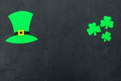St. Patrick`s Day theme colorful horizontal banner. Green leprechaun hat and shamrock leaves on black background. Felt craft elem. Ents. Copy space. For greeting royalty free stock image
