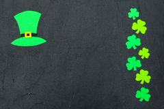 St. Patrick`s Day theme colorful horizontal banner. Green leprechaun hat and shamrock leaves on black background. Felt craft elem. Ents. Copy space. For greeting royalty free stock photos
