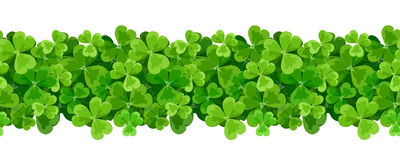 St. Patrick`s day vector horizontal seamless background with shamrock. Stock Photo