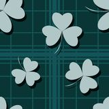 St. Patrick`s day vector seamless pattern made with checkered background and green shamrocks. Vector illustration. Eps 10 Royalty Free Stock Images