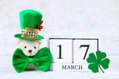 St.Patrick `s Day. A wooden calendar showing March 17. Green hat. And bow Royalty Free Stock Photos