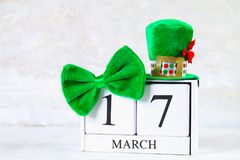 St.Patrick `s Day. A wooden calendar showing March 17. Green hat and bow. St.Patrick `s Day. A wooden calendar showing March 17. Green hat and bow Stock Photos