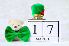 St.Patrick `s Day. A wooden calendar showing March 17. Green hat and bow. St.Patrick `s Day. A wooden calendar showing March 17. Green hat and bow Stock Image
