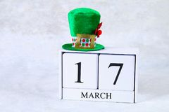 St.Patrick `s Day. A wooden calendar showing March 17. Green hat. And bow Royalty Free Stock Images