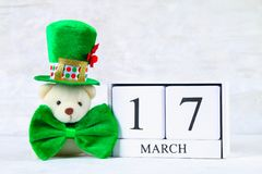 St.Patrick `s Day. A wooden calendar showing March 17. Green hat. And bow Stock Photos