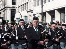 St patrick's parade. Musicians playing instruments in london on st patrick day Royalty Free Stock Images