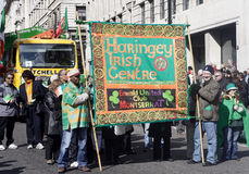 St patrick's parade ethnic diversity. Ethnic diversity people holding a banner Stock Photos