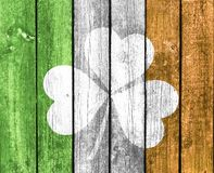 St Patrick`s shamrock. A close up of St Patrick`s shamrock on a wooden background in the colors of the Irish flag Royalty Free Stock Photo