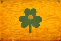 St. Patrick shamrocks. Happy St. Patrick's Day! textured green & gold shamrocks on a rich golden hued wood background, lots of space for copy. I am the artist of Royalty Free Stock Photos