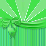St.Patricks background with a green satin ribbon and bow. Stock Images