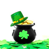 St Patricks Day. St Patrick's Day pot of gold with shamrocks and hat over white Royalty Free Stock Photo