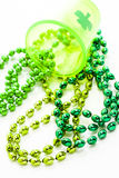 St. Patricks Day. Doilies on green background Stock Photos