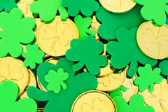 St Patricks Day background. Of shamrocks and gold coins Royalty Free Stock Photos