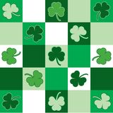 St. Patricks Day Background. Green and white checkered background pattern with shamrocks Stock Photos