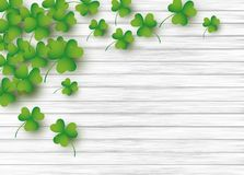 St Patricks day background design of clover leaves. On white wood with copy space vector illustration vector illustration