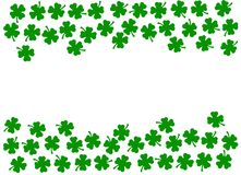 St Patricks Day festive background - double side border of green quatrefoils isolated on white stock illustration