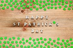 St Patricks Day background. Green quatrefoils on the wooden background and inscription Happy St Patrick`s day stock photography