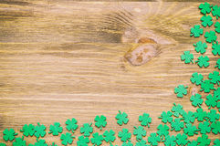 St Patricks Day background with green quatrefoils on wooden background. St Patricks Day background - green quatrefoils on the wooden surface stock images