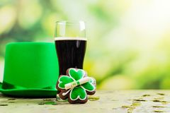St Patricks Day background. Happy St Patricks Day background with leprechaun hat, shamrock shaped glasses and ale. Greeting card. Copy space stock photo