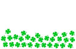 St Patricks Day festive background - upper border of green quatrefoils isolated on white stock illustration