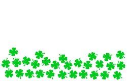 St Patricks Day festive background - upper border of green quatrefoils isolated on white stock illustration