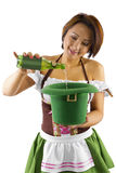 St Patricks Day Bartender. Young Asian female bartender dressed in costume for St Patrick's Day performing a magic trick Royalty Free Stock Photo