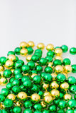 St. patricks day beads with copy space. Close up and isolated on white background, vertical Royalty Free Stock Photography
