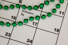 St. Patricks Day beads kept on calendar Stock Photo