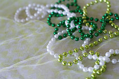St. patricks day beads. St. patty day or mardi gras beads Stock Image