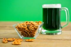 St Patricks Day beer with pretzel Stock Image