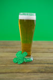 St Patricks Day beer with shamrock. St Patric's Day beer with shamrock on wooden surface Royalty Free Stock Photos